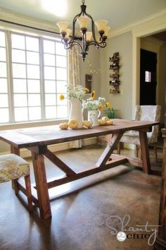 DIY farmhouse dining table plans  http://ana-white.com/2013/09/plans/4x4-truss-beam-table
