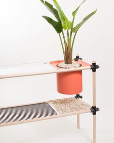 @_stephenroy designed a system of metal brackets that enable the creation of cool pieces of furniture, like this plant stand. Photo by @johanislr.