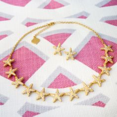 The Boca Necklace is beach glamour. Tiny crystals add sparkle to this brushed gold starfish necklace.