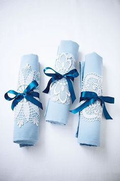 Add decorative accents to your napkins by wrapping a fabric doily around each one and securing it with ribbon.- Good idea for Cora's first birthday. Wrap silverware in napkins, attach a cut out snowflake and tie!