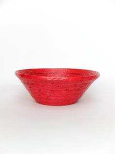 The Orange Bicycle - Small Round Bowl - Red - These eco-friendly products are very asthetically made from recycled paper,by an NGO called Wellpaper, each design is very unique in itself, & will give a very earthy touch to your home decor.