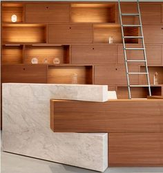 Commercial Casework architectural millwork firm #reception area detail. #custom #woodworking See more: http://www.woodworkingnetwork.com/wood-market-trends/woodworking-industry-news/production-woodworking-news/Commercial-Casework-Fastest-Growing-Bay-Area-Firm-228559301.html