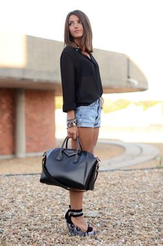Black sheer top, light jean cut-offs & black and white ankle strap wedges. Stylish and relaxed.