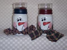 Snowman Candle Jars This pint-sized jar features a snowman's face complete with scarf of homespun and trimmed in nave blue, hunter green or burgandy. Comes complete with votive cup and candle; in a clear bag with jute string.