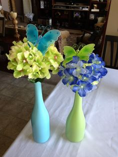 Simple butterfly wedding decor using wine bottles   Easy DIY wedding or shower centerpieces.