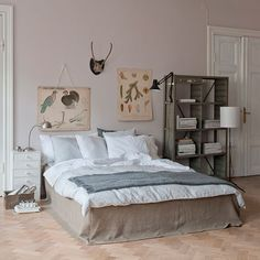 Love the neutral color palette...of course this is to grown up for the boys but I do love those images hanging on the wall and have seen a lot of those at a shop near by that are affordably priced so probably incorporate those into Zac's room.