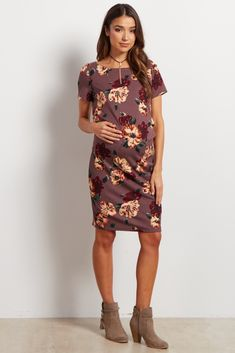 This floral, fitted dress is your perfect, must-have versatile dress. Wear to date night or even to the office. A super comfortable fitted style effortlessly shows off your baby bump. Dress this piece up with heels and a statement necklace for work or wear with flats for casual wear.