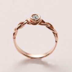 A braided rose-gold engagement ring embodies the innocent blush of true love. #etsyweddings