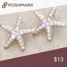 Gold Tone Pearl Pink Crystal Starfish Beach Studs Gold tone nautical beach theme statement size stud earrings feature white imitation pearls and glittering iridescent pink crystals set at the center.  These awesome stud earrings have posts with friction backs and measures 7/8 inch L x 7/8 inch W. Jewelry Earrings