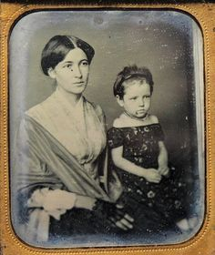 Why choose one daguerreotype over another? I love this woman's face. I love the soft neckline of her plaid bodice. There is something very gentle about her. The plaid suggets the mid1850s.