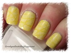Yellow nails with groovy lines.  #Brandy's Nailtastic Blog