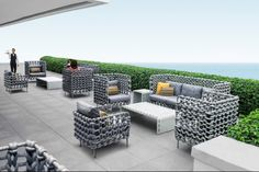 Kenneth Cobonpue : Collections : CABARET  The Cabaret Collection is inspired by the simplicity and subtle beauty in the art of knitting. Weaving fabric-wrapped foam on a steel frame conveys the next generation of the evolving outdoor luxury furniture market.
