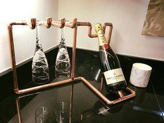 Items similar to Copper Wine Rack and Two Glass Holder (Hand Crafted) on Etsy Copper Wine Rack, Industrial Wine Racks, Modern Wine Rack, Copper Lamps, Copper Decor, Copper Pipes, Wine Glass Holder, Wine Bottle Holders, Copper Wire Crafts