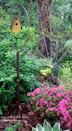 A rusty bird cage stand repurposed (Garden of Len & Barb Rosen)