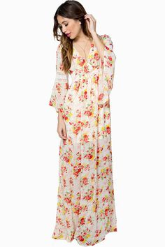 Channel some 70's chic in this floral maxi dress! Deep v-neck. Empire waist. Long bell sleeves with crochet insets. Self-tie in the back. Floor-length hem. Fully lined. Chiffon overlay.