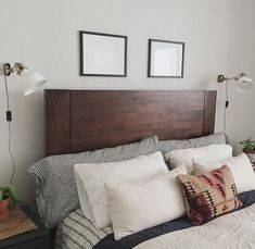 IKEA Ranarp wall lamps | west elm bed frame and bedding | kilim pillow | handmade art | vintage mid century bed side tables | succulents
