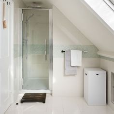 Clever tricks with tiles When decorating a small bathroom, such as an en suite in a loft conversion, introduce a horizontal line around the width of the space, either with tiles or paint. This trick will visually widen the space, creating the illusion of a bigger room.