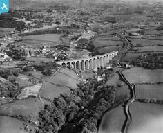 View of Merthyr Tydfil, showing Cefn Viaduct, oblique aerial view. black and white glass plate negative. New Bus, Over The River, Bus Station, Water Tower, Aerial View, Brewery, Wales, Britain, The Past