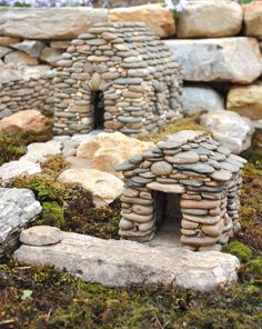 Mini stone houses,  Made a Fairy House like this on an old moss covered slice of wood. Used big pieces of bark for the roof and hot glued tiny sticks to make a door.  Don't know about the fairy thing, but I think this is adorable for Amber's garden - for Summy and the boys!