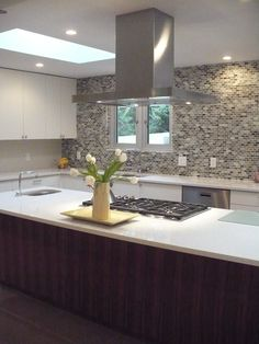 Contemporary kitchen - centralised cook top on island - cool hood vent! Kitchen Hoods, Contemporary Kitchen, Kitchen Remodel, Kitchen Design, Kitchen, Kitchen Cooktop, White Shaker Cabinets, Dream Kitchen, Shaker Cabinets