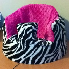 Bumbo seat cover made by Baby Bankies and Bibs.