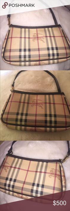 Authentic Burberry 'Check' Mini Shoulder Bag Gently used in excellent condition Burberry Mini Shoulder bag. Interior credit card pocket. Includes logo sleeper bag. Fits iPhone, keys & lipstick. Perfect for going out in the evenings & parties. One of my favorite bags but I'm in grad school and need to sell things I rarely use Bags Mini Bags