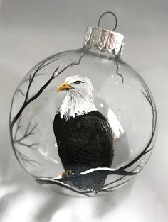 Bald Eagle American Freedom Hand Painted Glass Sphere Christmas Tree Ornament Northern Woodland Great Outdoors Bird Patriotic Unique Gift  The bald eagle hanging out in a snow scene is an unique, rustic and beautiful ornament that will make a big impact on any holiday collection. These ornaments make very special gifts for birthdays, housewarmings and even weddings!  All my ornaments are made to order and can be customized to say whatever you wish! Each ornament is hand painted by me with my…