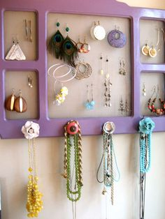 don't like this purple thing at all but love the idea of fun knobs along bottom to hang bigger stuff.