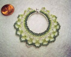 green netted pendant  silver, lime, & green silver-lined seed beads (size 11); edge stitching & netted stitching on silver hoop.