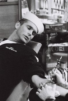 Rob Lang Photography - Sailor getting a tattoo  -  Rule # 1:  Get a little drunk first; Rule # 2: DON'T WATCH!!!!!!