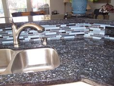 Blue Pearl Granite with matching backsplash. This is going in my house in a few weeks!