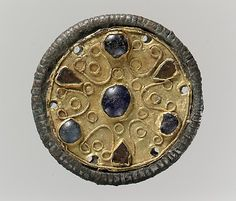 500-600 AD. Disk Brooch Gold, wire, glass paste cabochons, copper alloy core Dimensions: Overall: 1 5/16 x 3/8 in. (3.4 x 1 cm)