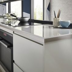 Clerkenwell Gloss Dove Grey Kitchen | Contemporary Kitchens | Howdens Joinery