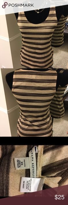 🎁BF-SALE 30%⬇️Banana Republic metallic tank Banana Republic brown & tan metallic tank - really pretty with blazer & slacks the metallic adds a great touch of sparkle for the upcoming season!! 🔴Price is FIRM❣️but you can bundle & save! This is the Lowest price for this item❣️❣️ ☑️I ship same or next day!! Banana Republic Tops Tank Tops
