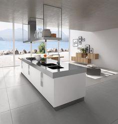 Ilot de #cuisine blanche avec idée aménagement #déco et plan de travail en inox