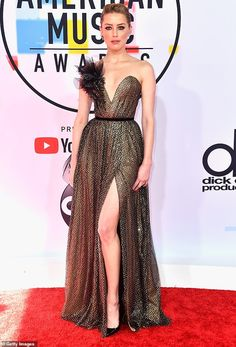 Amber Heard shows off her slender stems in black and gold gown at AMAs 8be06bba7ad3