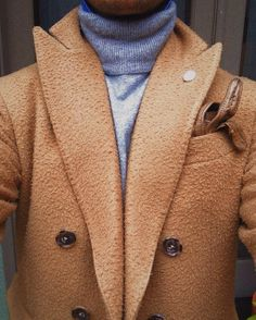 Close up of turtleneck sweater and Casentino coat
