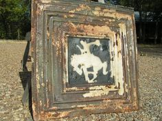 Ancient tin tile with cowboy stencil