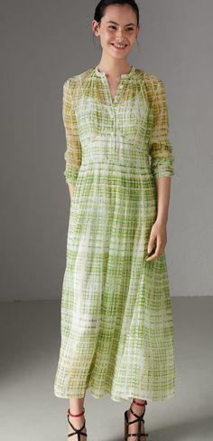 A sheer #Burberry silk dress defaced with a scribble check print and shaped with soft gathers