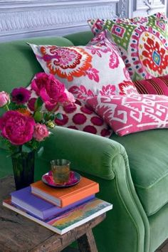 Green Velvet Sofa with fun, bright pillows