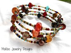 Stone, seed bead glass and copper wrap around memory wire bracelet.