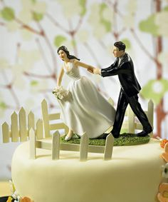 A Race to the Altar Couple Figurine Cake Topper.