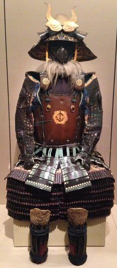 A Gomai-Do Yukinoshita armor. Edo Period, 17th century. The fukigaeshi with gold-lacquered crests of opposed sparrows within a bamboo circle (mon of the Date clan). The menpo (facemask) of black-lacquered iron with detachable nose in the form of a large bird (or tengu) beak. -Christie's. Sale 2378. Arts of the Samurai-