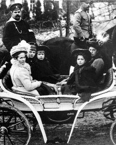 "The Grand Duchesses Anastasia and Maria Nikolaevna Romanova of Russia,Tsarevich Alexei Nikolaevich Romanov of Russia with his sailor nanny,Andrei Deverenko and their nannies. ""AL"""