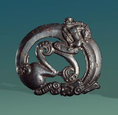 Bridle Plaque with a Beast of Prey Curved Round | Scythian Culture | 5th century BC