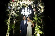 A fabulously fun wedding at Burkill Hall, Singapore Botanic Gardens. Love this floral arch complete with hanging chandelier! Photo by Schnap Photography. #wedding #singapore #singaporewedding