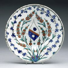 Dish with European Coat-of-Arms Ceramic (stonepaste, moulded), with copper-green, cobalt-blue, iron-red, and chromium-black paint, and tran... Ceramic Pottery, Pottery Art, Green Copper, Plates And Bowls, Earthenware, Islamic Art, Cutlery, Cobalt Blue, Contemporary Artists