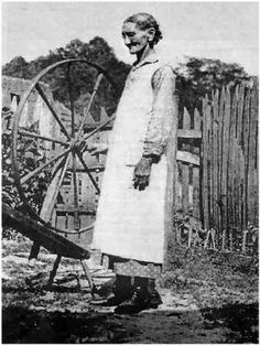 """Aunt Viannah"" Blevins with wheel at the Blevins homestead in the Station Camp Creek area of Scott County, Tennessee."
