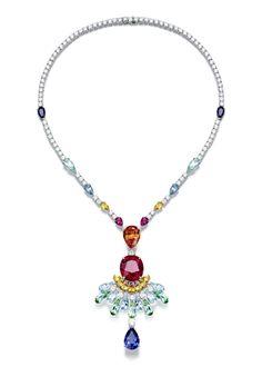 Piaget #Rose Passion #necklace in white #gold set with #diamonds, 1 orange garnet, 3 blue sapphires, 9 yellow sapphires, 8 aquamarines, 7 green tourmalines, 3 rubellites.