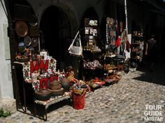 Photo of the souvenirs, handcrafts and shops on the streets of Old Town in Mostar. #mostar #TGM #TourGuideMostar #souvenirs #europe #handcrafts #architecture #paintings #citylife #tradition #herzegovina
